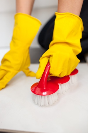 woman cleaning: Close-up of a woman cleaning a bathrooms floor