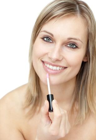 Smiling woman putting gloss Stock Photo - 10093936