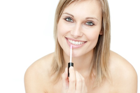 gloss: Attractive woman putting gloss  Stock Photo