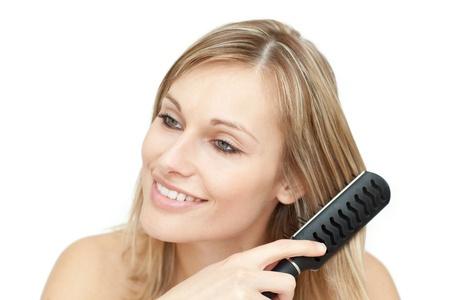 Beautiful blond woman brushing her hair Stock Photo - 10093310