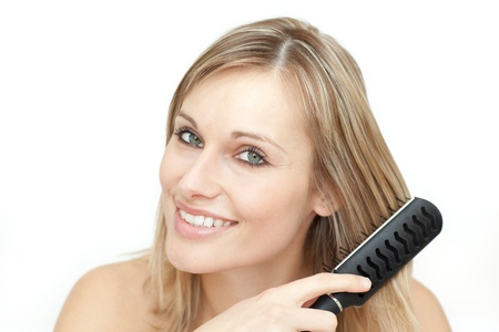 Radiant blond woman brushing her hair Stock Photo - 10093503