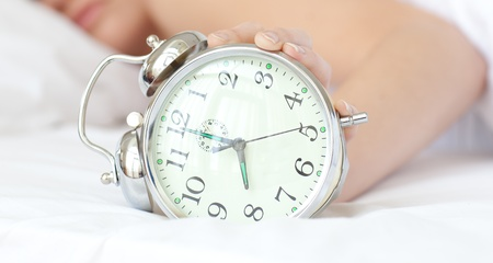 turning table: Close-up of a woman holding an alarm clock