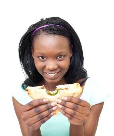 Joyful young woman eating a sandwich photo