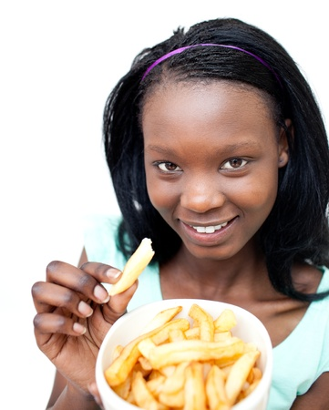 Charming young woman eating fries  photo