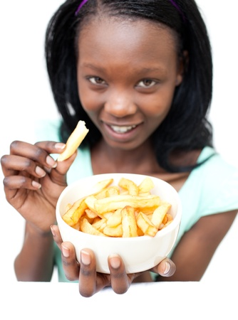 Attractive young woman eating fries  photo
