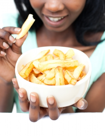 Young woman eating fries  photo