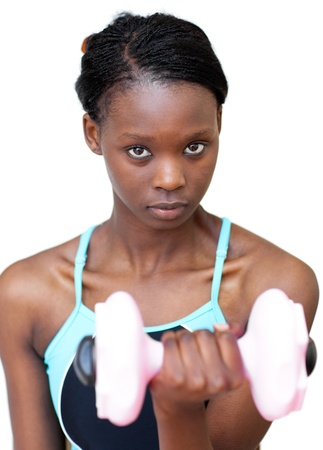 Attractive woman working out with dumbbell  photo