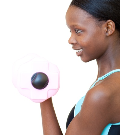 Positive woman working out with dumbbell  photo