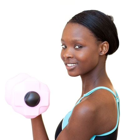 Charming woman working out with dumbbell photo
