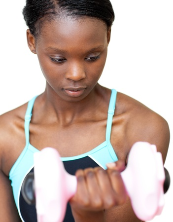 Serious woman working out with dumbbell  photo