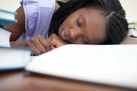 Exhausted woman sleeping while studying  Stock Photo - 10094625