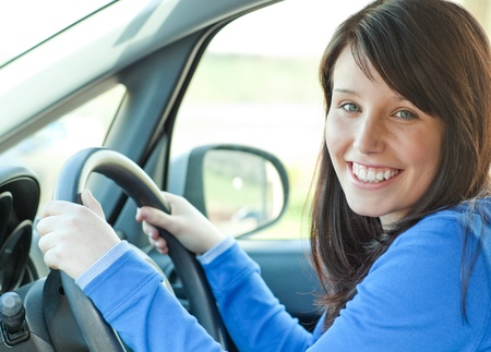 Young woman driving  photo