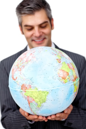 Mature businessman smiling at global business expansion  photo