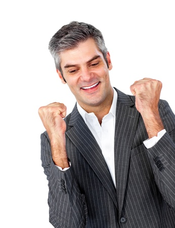 Mature businessman punching the air in celebration  photo