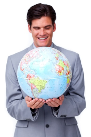 online internet presence: Assertive businessman smiling at global business expansion
