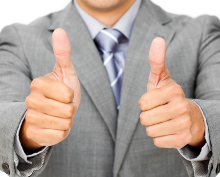 Close-up of a businessman with thumbs up photo