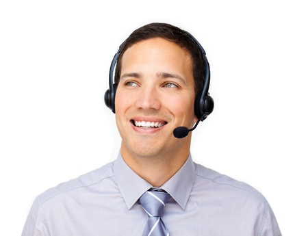 Smiling customer service agent using headset Stock Photo - 10076050