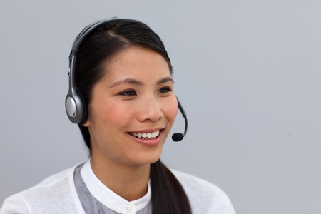Charming young businesswoman with headset on photo