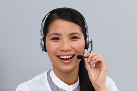 Laughing ethnic businesswoman using headset photo