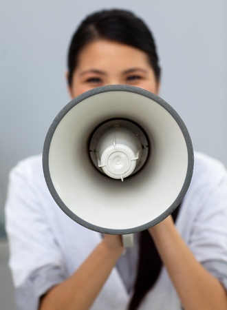 Self-assured businesswoman shouting instructions  Stock Photo - 10078721