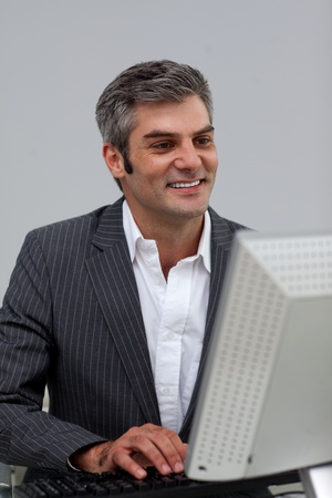 Mature male executive working at a computer  photo