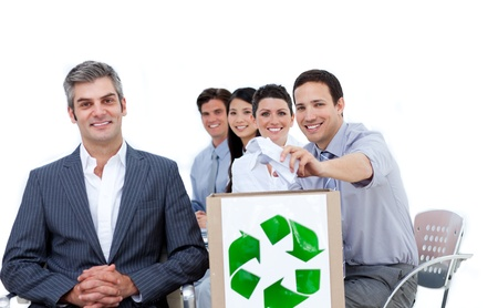 international recycle symbol: Happy business people showing a recycle sign Stock Photo