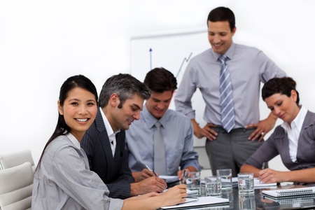 Confident young businessman presenting to his team photo