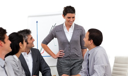 Confident manager presenting to her team Stock Photo - 10093594