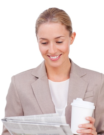 Young businesswoman drinking a coffee reading a newspaper  photo