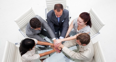businessmeeting: High angle of business people with hands together