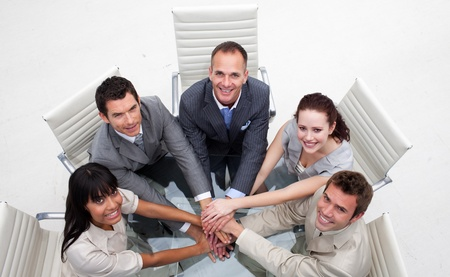 businessmeeting: Smiling business team with hands together