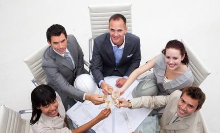 Group of architects celebrating a success in the office Stock Photo - 10093929