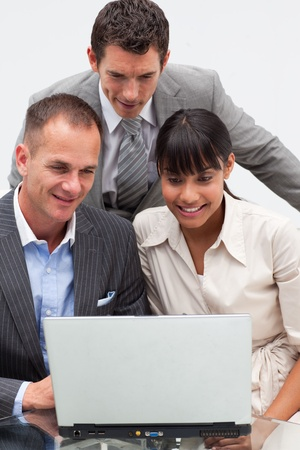 businessmeeting: Two businessmen and a businesswoman using a laptop