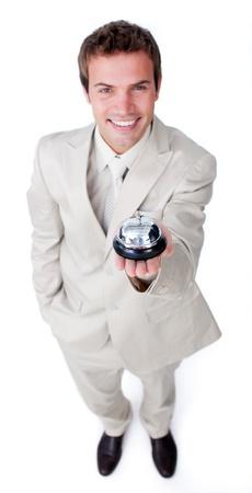 Caucasian businessman using a bell Stock Photo - 10075974