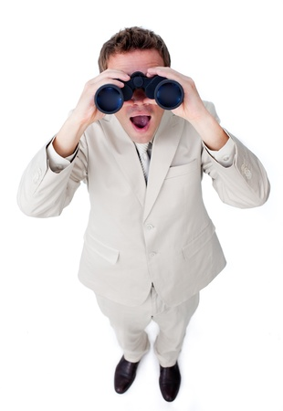 Confident businessman using binoculars photo