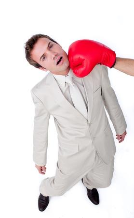 Caucasian businessman taking a hit  photo