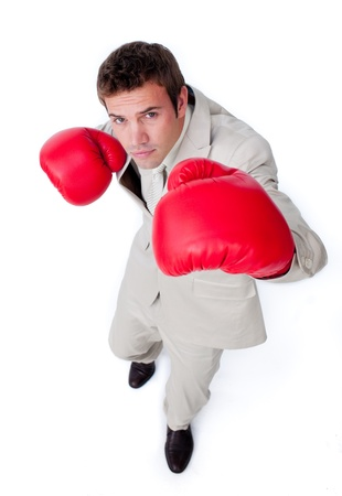 Caucasian businessman wearing boxing gloves Stock Photo - 10076094