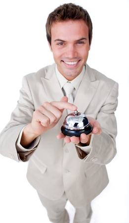 Smiling businessman is using a bell Stock Photo - 10077645