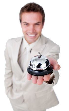 Charming businessman is using a bell photo