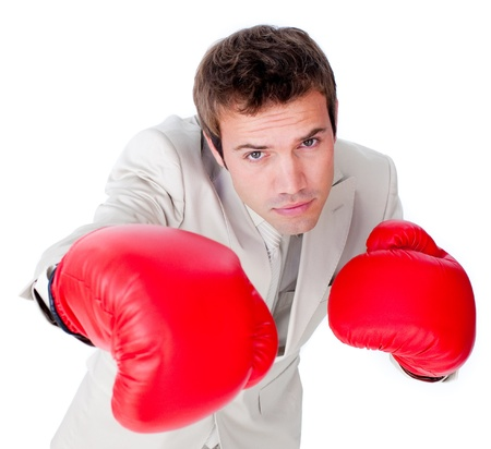Positive businessman wearing boxing gloves Stock Photo - 10075892