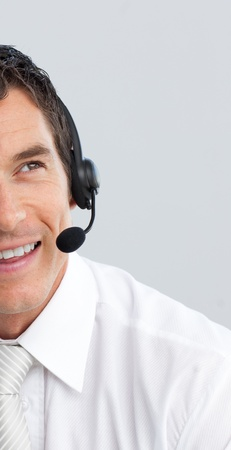 hotline: Portrait of a businessman with a headset on Stock Photo