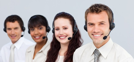 Smiling team working in a call center photo