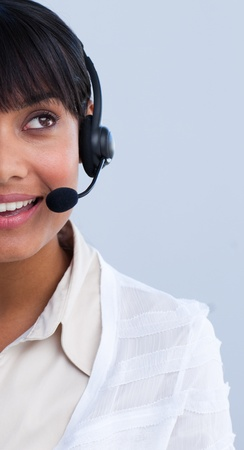 Close-up of an attractive ethnic businesswoman in a call center Stock Photo - 10076113
