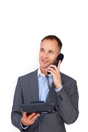 llamando: Empresario positivo hablando por un tel�fono  Foto de archivo