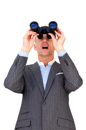 Surprised businessman looking through binoculars  photo