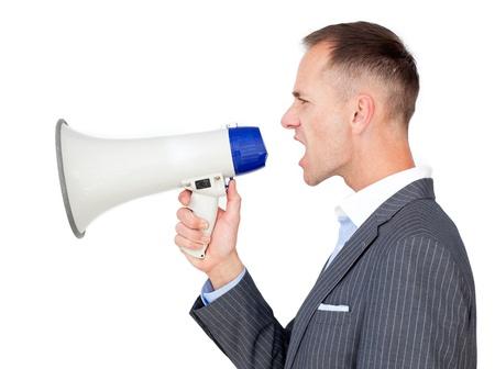 Caucasian businessman holding a megaphone Stock Photo - 10076857