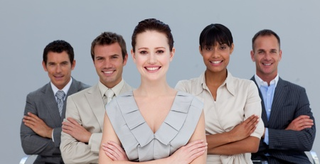 Multi-ethnic business team with folded arms Stock Photo
