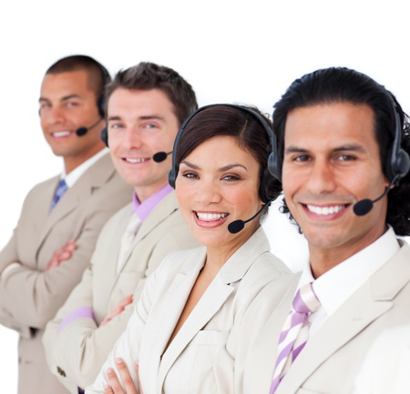 Smiling business team lining up with headset on photo
