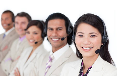 representative: Concentrated business people working together Stock Photo