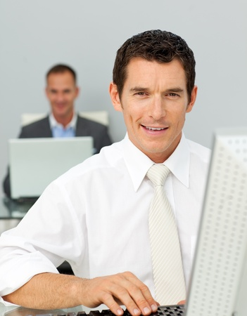 businessman working at his computer: Confident businessman working at his computer  Stock Photo
